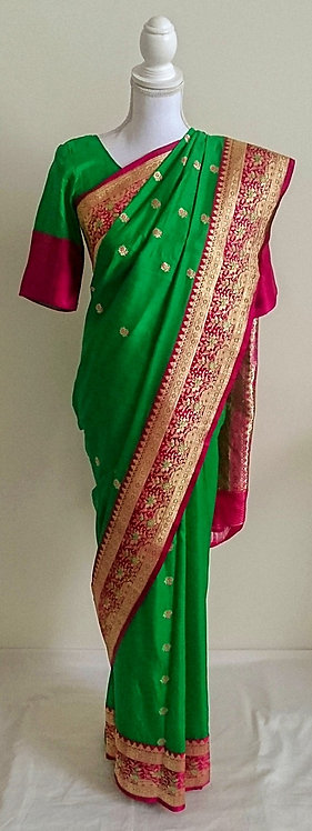 Stunning green and dark pink silk sari with gold thread border