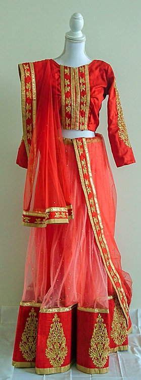 Beautiful peach and burnt orange lengha with gold diamonte work throughout