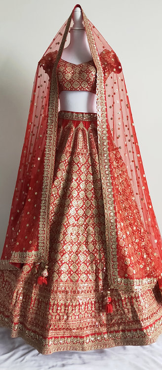 Beautiful fire engine red and gold bridal lengha