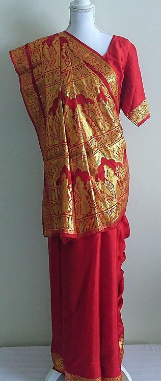 Stunning silk dark orange sari with heavy gold pallu