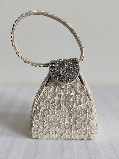 Stylish cream clutch with silver diamonte feature