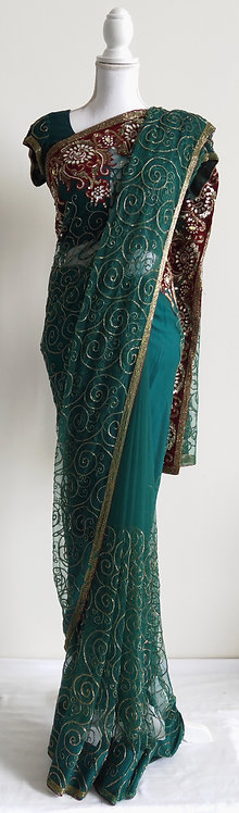 Beautiful deep green net sari with golden bead embroidery