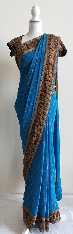Gorgeous blue printed chiffon sari with brown thick border