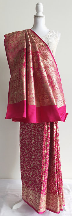 Beautiful magenta banarsi silk bridal sari with gold zari design
