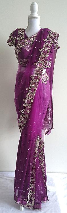 Sparkly purple net sari semi pleated sari with heavy stonework
