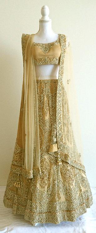 Beautiful three piece golden bridal lengha