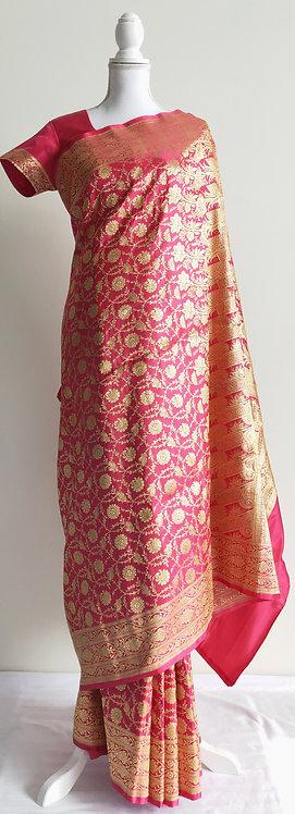 Beautiful dark pink banarsi silk bridal sari with gold zari design
