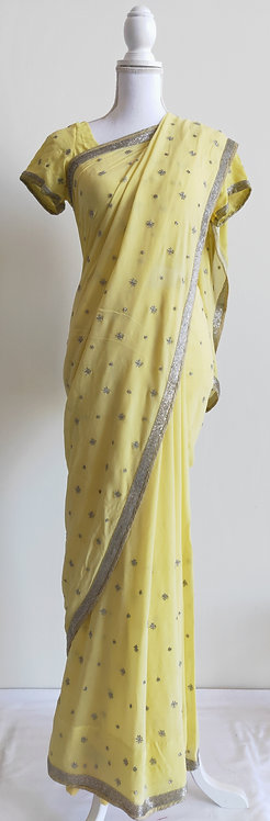 Beautiful pale yellow sari with silver sequin work throughout