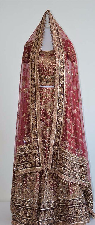 Stunning rose pink bridal lengha with velvet maroon borders and heavy embroidery