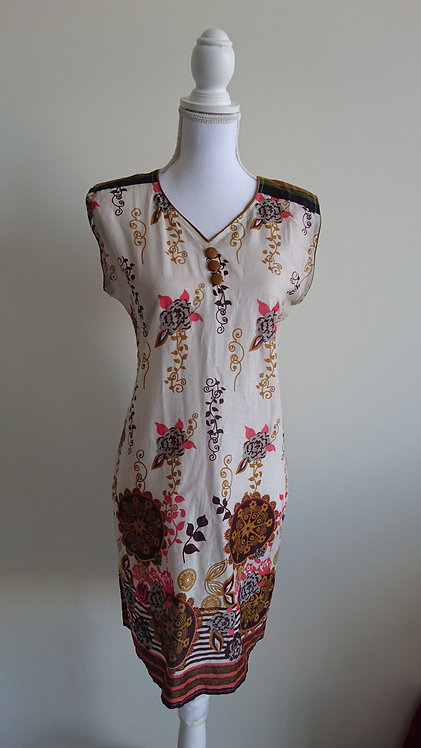 Stylish cotton white kurti top with floral pattern throughout