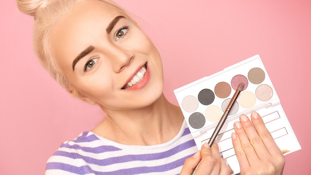 Woman filming her first YouTube makeup video