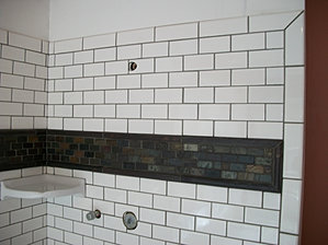 2x4 Subway Tile With Stone Border Surface Creations Bathrooms