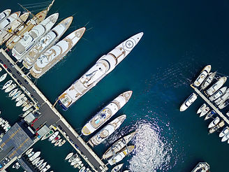 A stunning view of mega yachts in Port H