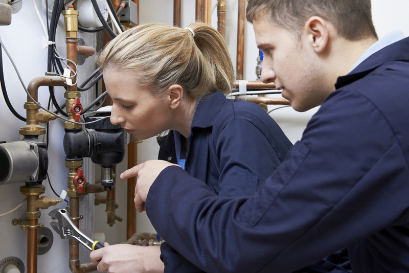 Man and women consulting on central heating installation
