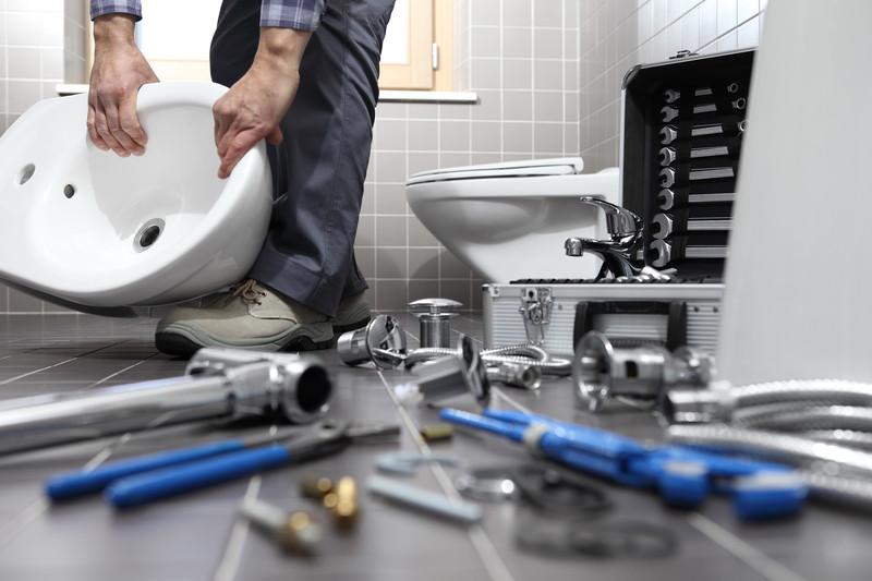 man installing new bathroom