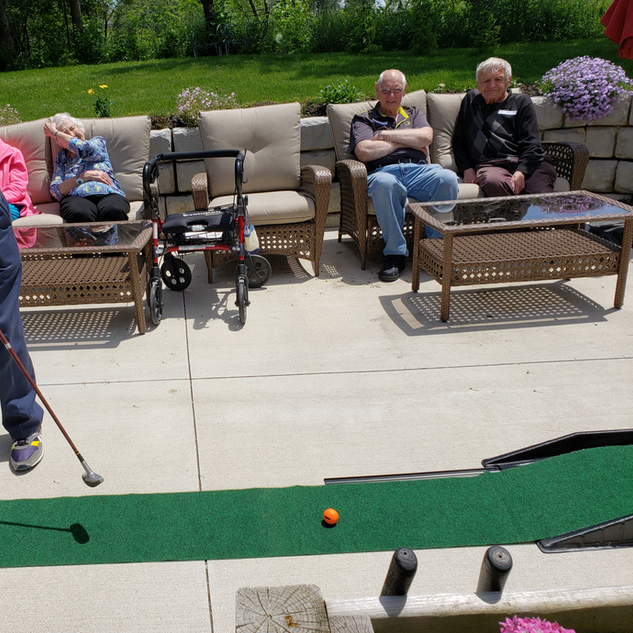 Goderich Place residents playing mini golf