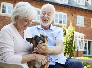 Palisade Gardens Independent Living - smiling couple with dog