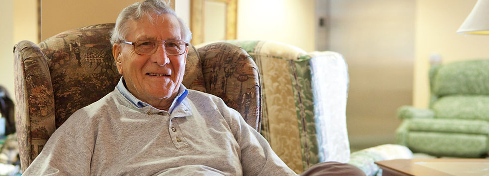 Goderich Place resident sitting in chair