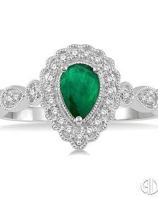 Ladies pear shape emerald diamond ring.j