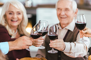 Palisade Gardens Full Service Retirement living - friends celebrating with red wine