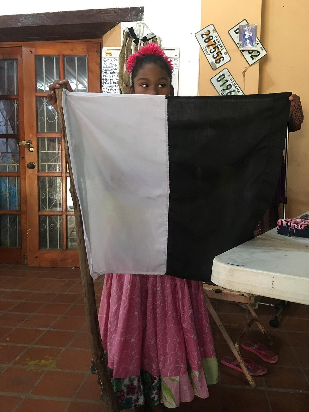 A flag one side white, one side black