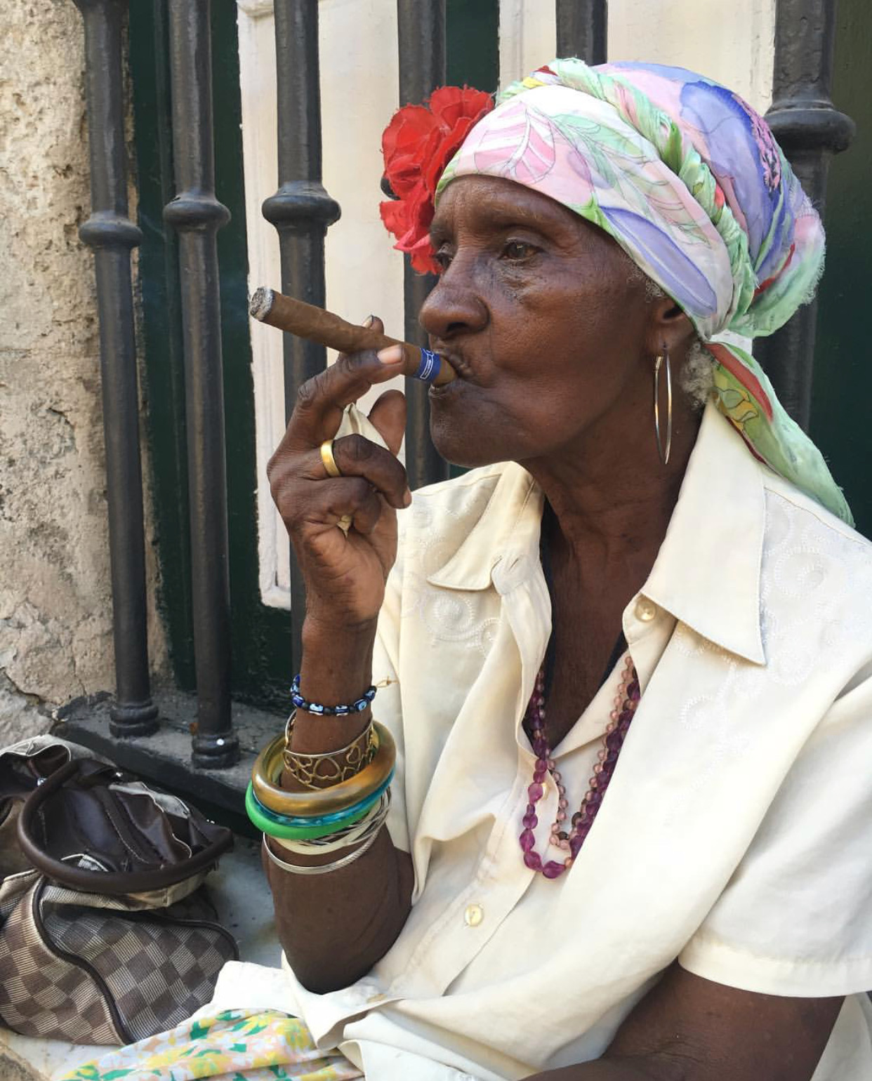"Th ubiquitous ""cigar lady,"" is actually based on the AfroCuban espiritista, smoking tobacco (an indi"