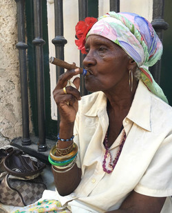 """Th ubiquitous """"cigar lady,"""" is actually based on the AfroCuban espiritista, smoking tobacco (an indi"""