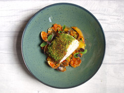 Almond picada crusted cod with chorizo and clam stew