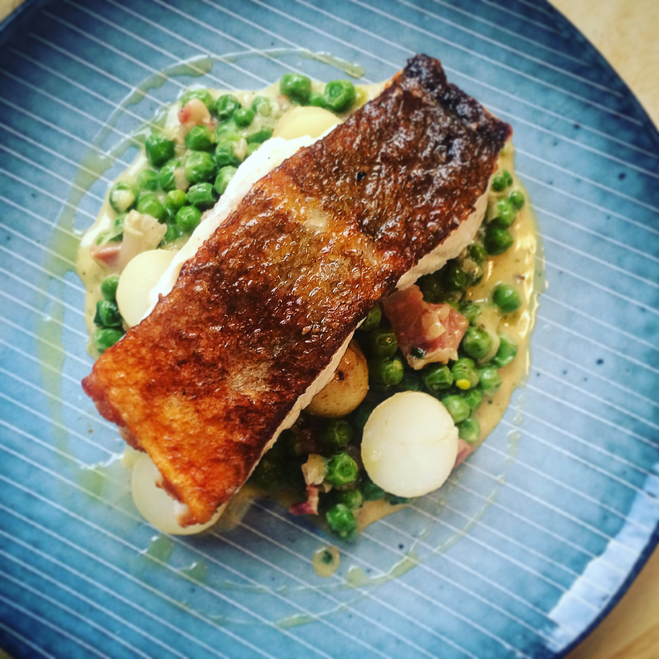 Pan fried cod with creamy peas