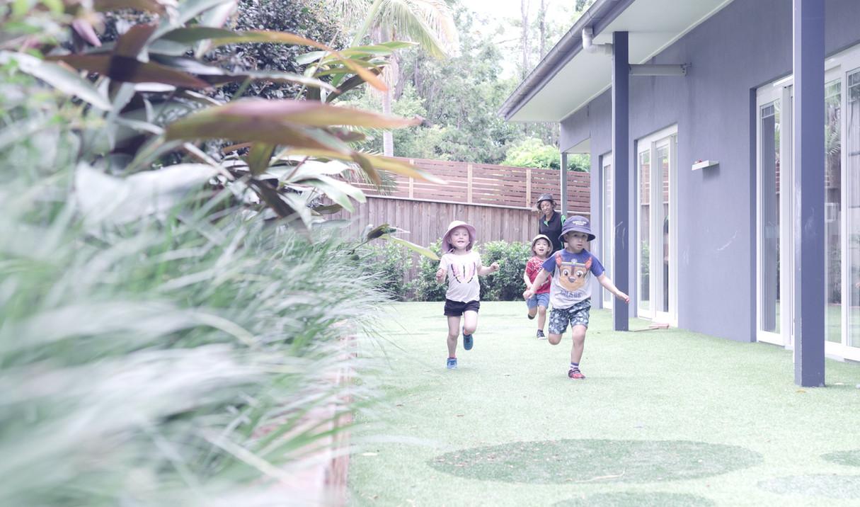 Preschoolers running in our yard