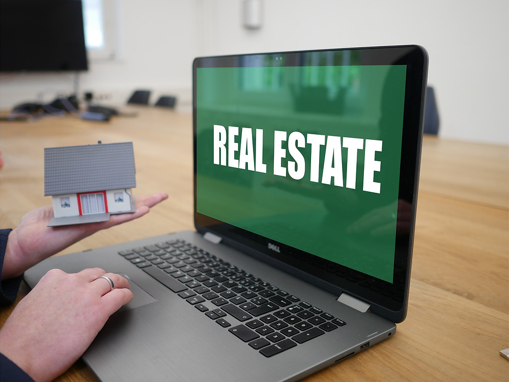 Real estate spelled out on computer screen