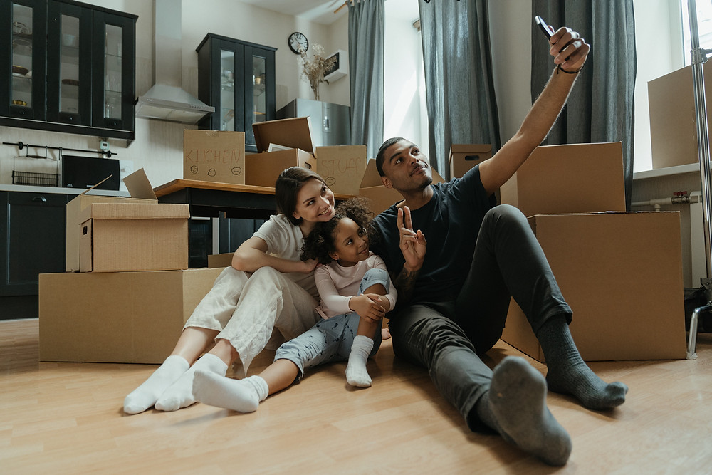 Family taking picture in newly rented home