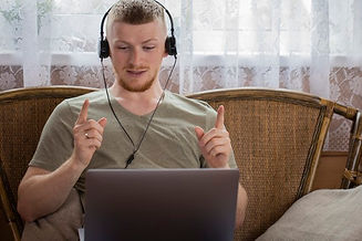 attractive-young-man-headphones-works-wi