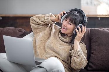 beautiful-smiling-girl-headphones-listen