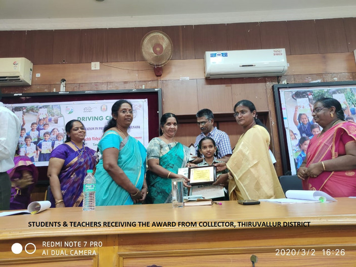 Students and Teachers receiving awards from Collector, Thiruvallur Dist.