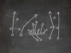 Football play strategy drawn out on a ch