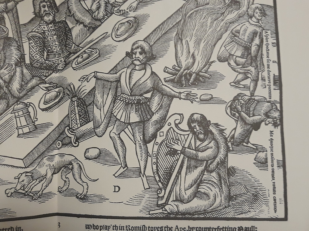 Derricke's woodcut of 1581: Irish feast with the two figures on the right.
