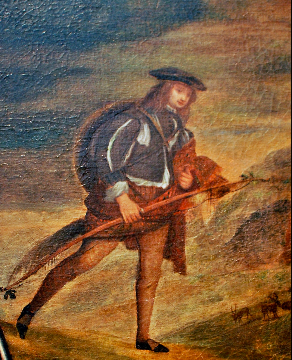 Sir Mungo's cearnach in slashed-out hodden gray doublet, with fur dorloch and very large targe on his back.