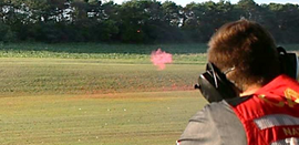 Carter breaking a flash target. Pooof.