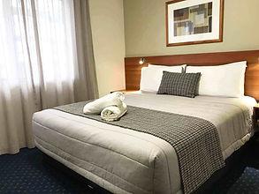 Deluxe Suite bedroom low res Diamond.jpg