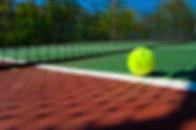 tennisballsoncourt.jpg