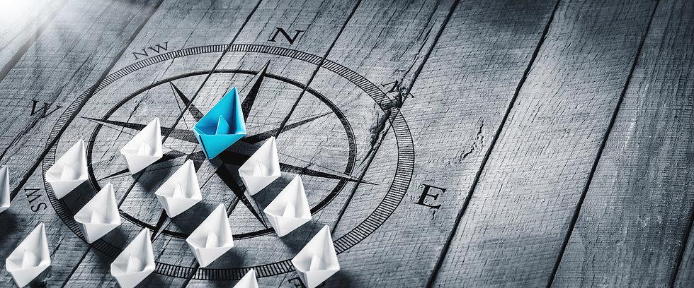 leadership-paper-boats-compass.jpeg