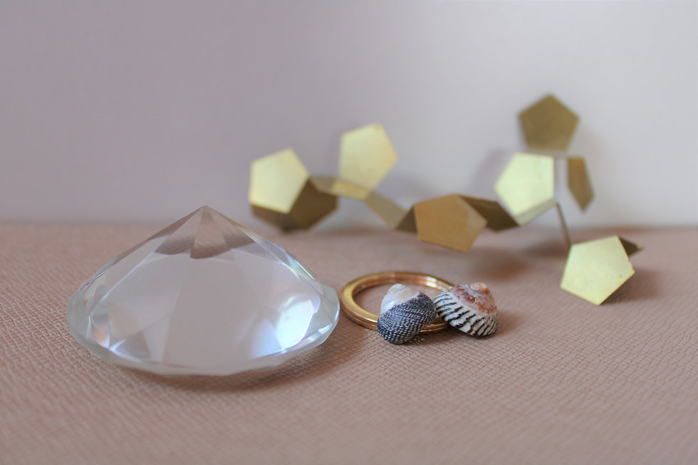 Kristall und Muscheln