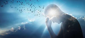 Silhouette of a man against a sky, sun a