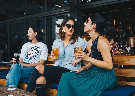 Canva - Three Women Holding Drinking Gla