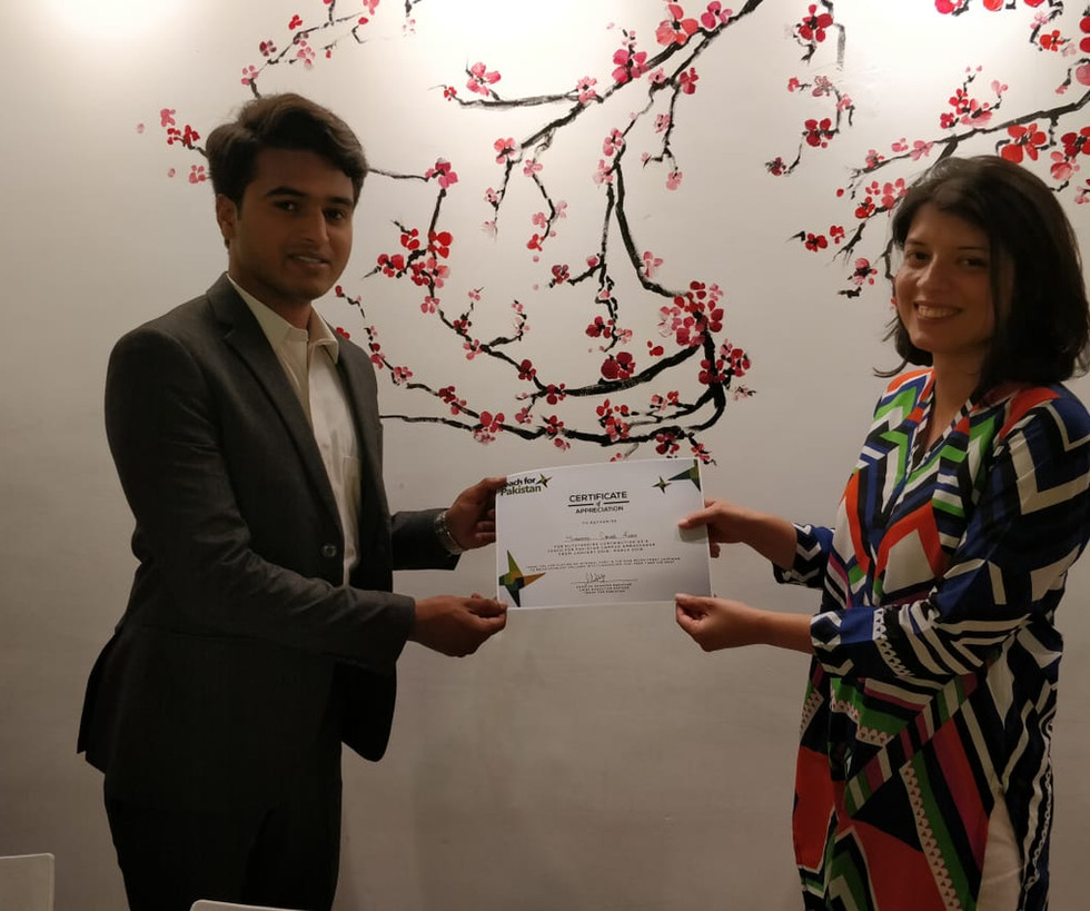 Maham Tanveer, Manager Recruitment and Selection giving the certificate of appreciation to our campus ambassador 2018