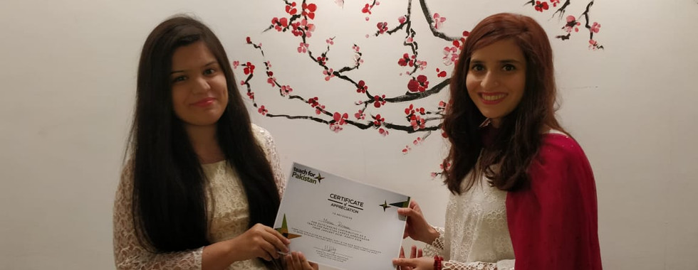 Rahat Abbassi, Associate Recruitment and Selection giving the certificate of appreciation to our campus ambassador