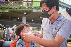bigstock-Parent-Putting-Mask-On-His-Asi-