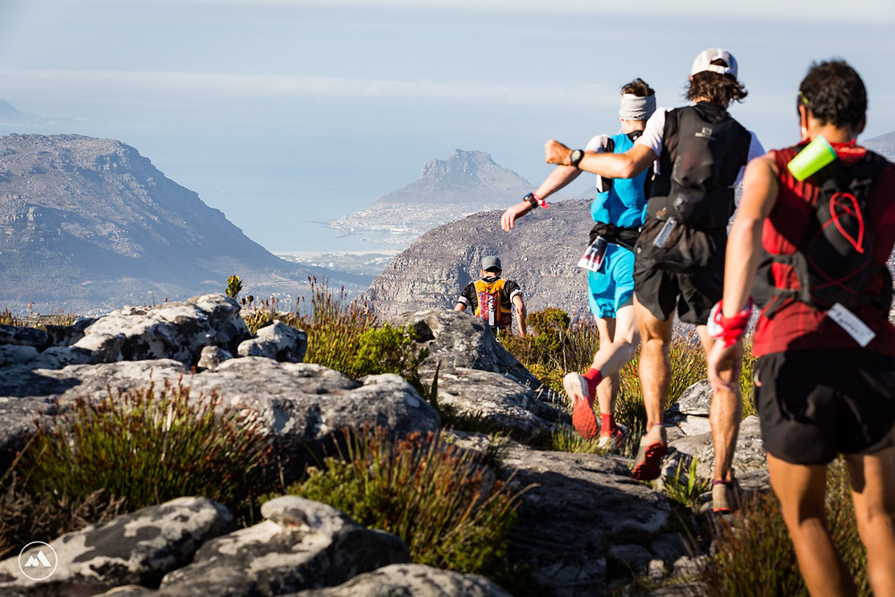Runners head towards Hout Bay during the UTCT.
