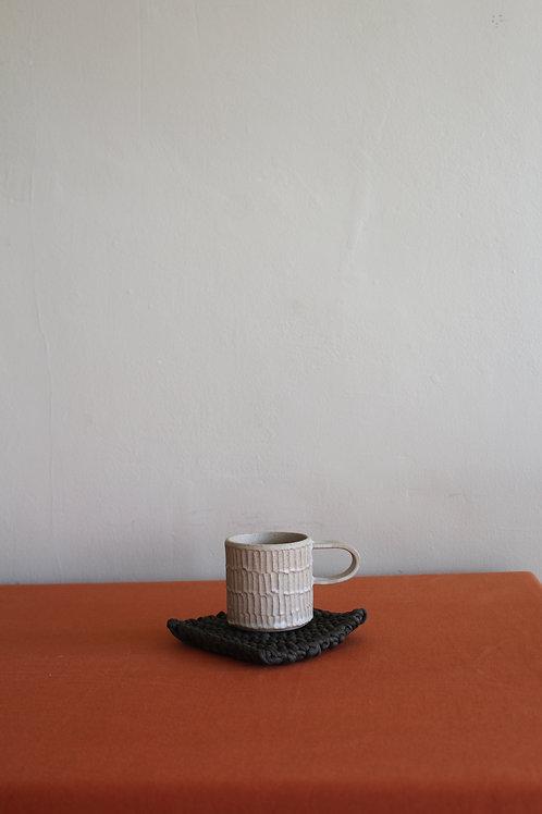 cream ridged coffee cup